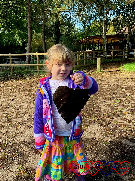 Sophie with a huge heart-shaped leaf