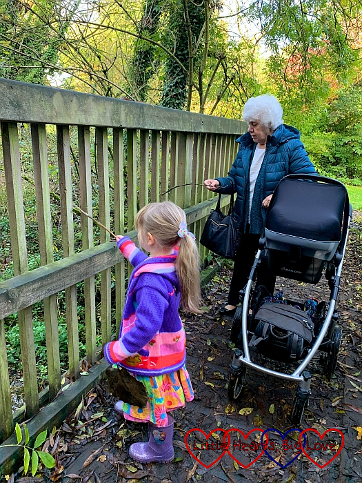 Sophie and Nanny playing pooh sticks