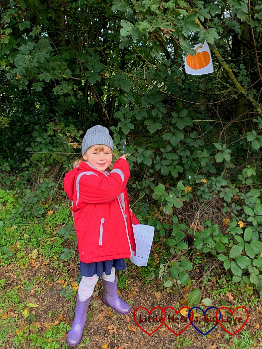 Sophie finding one of the pumpkin signs on the Halloween trail