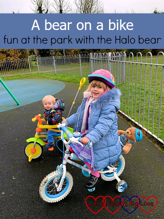 "Sophie on her bike with Walter strapped into the seat behind her and Thomas next to her on his trike at the park - ""A bear on a bike: fun at the park with the Halo bear"""