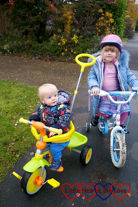 Sophie on her bike with Thomas on his trike