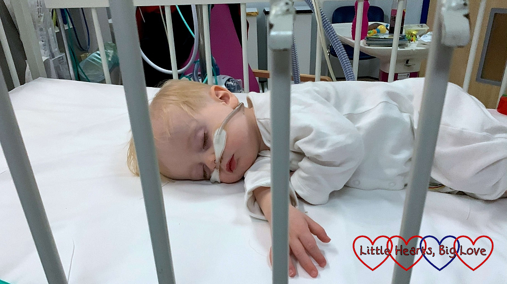 A sleeping Thomas in a hospital cot
