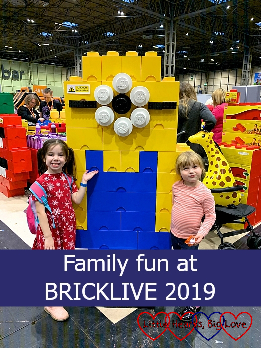 "Sophie and her friend next to a Minion made of large LEGO® storage bricks – ""Family fun at BRICKLIVE 2019"""