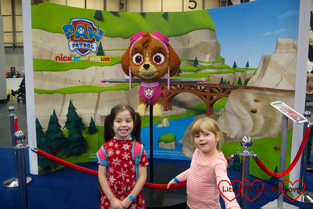 Sophie and her friend with a brick model of Skye from PAW Patrol