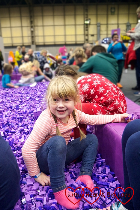 Sophie and her friend in the purple brick pit.