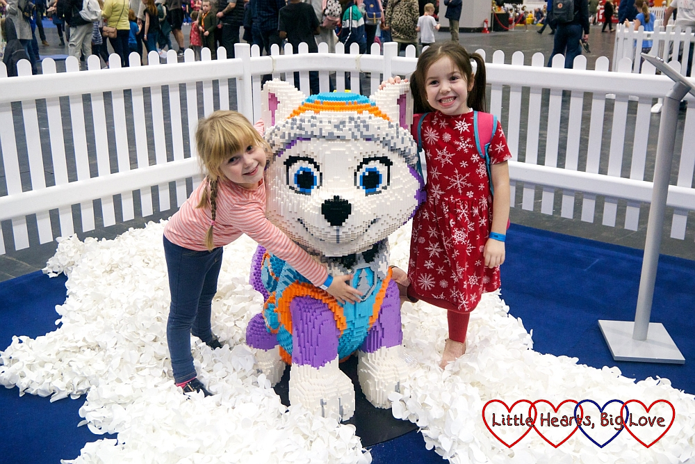 Sophie and her friend with a brick model of Everest from PAW Patrol