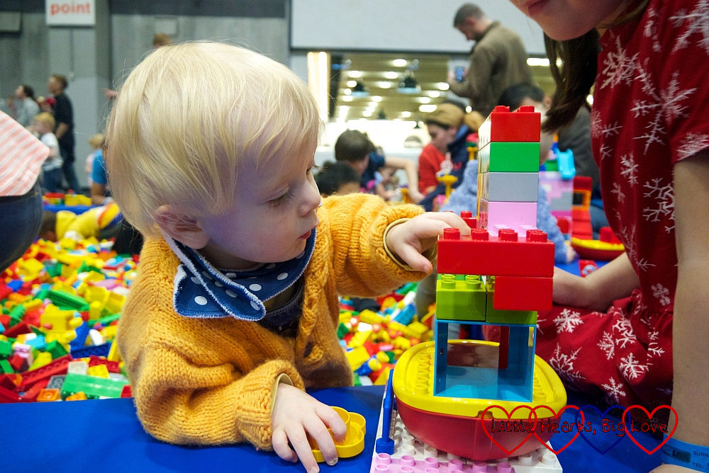 Thomas in the DUPLO® brick pit looking at the model that Sophie's friend built