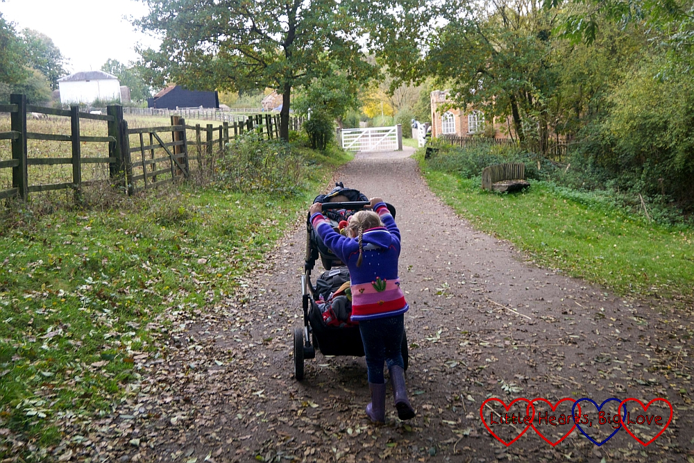 Sophie pushing Thomas in his buggy up the hill towards the High Wycombe Toll House