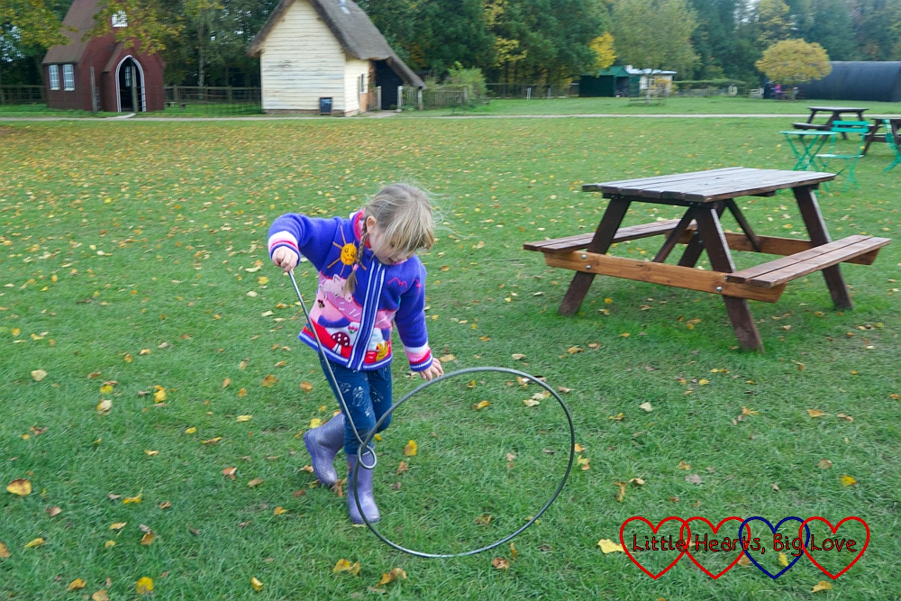 Sophie trying to run with an iron hoop