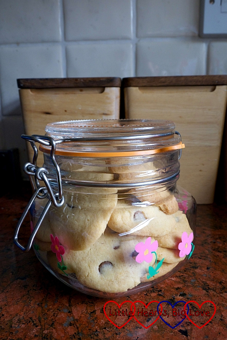 A decorated glass jar of cookies