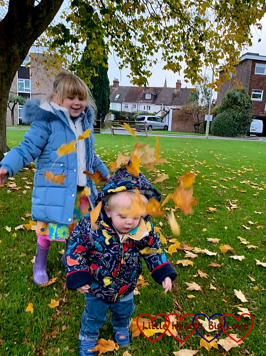 Sophie throwing leaves over Thomas