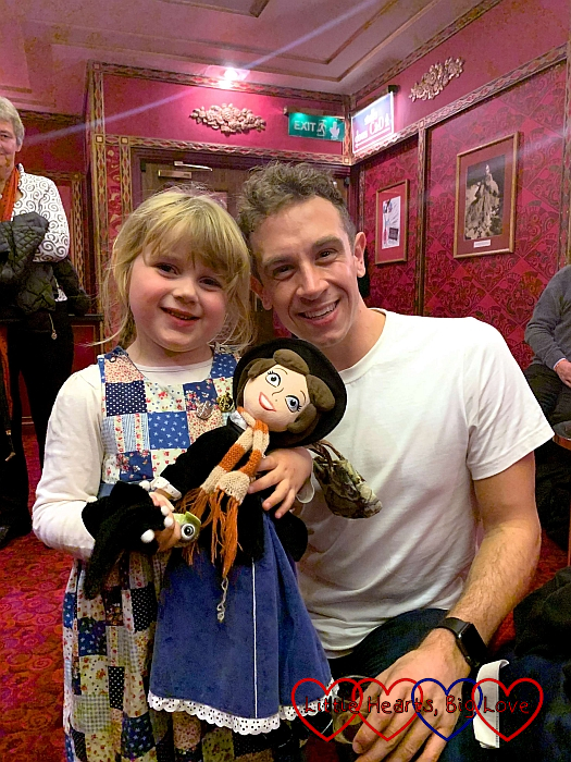 Sophie holding her Mary Poppins dolls and standing next to Charlie Stemp who played Bert