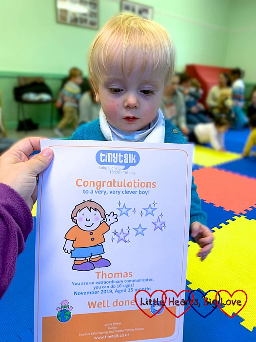 Thomas at Tiny Talk with his '10 signs' certificate