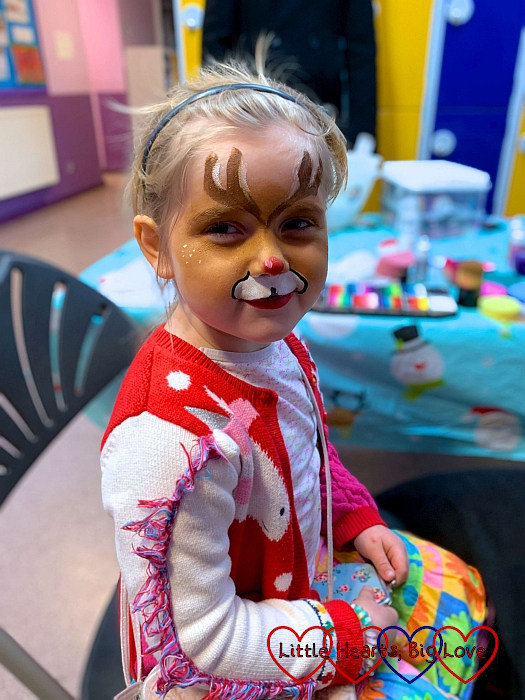 Sophie with her face painted like a reindeer at the school Christmas fayre