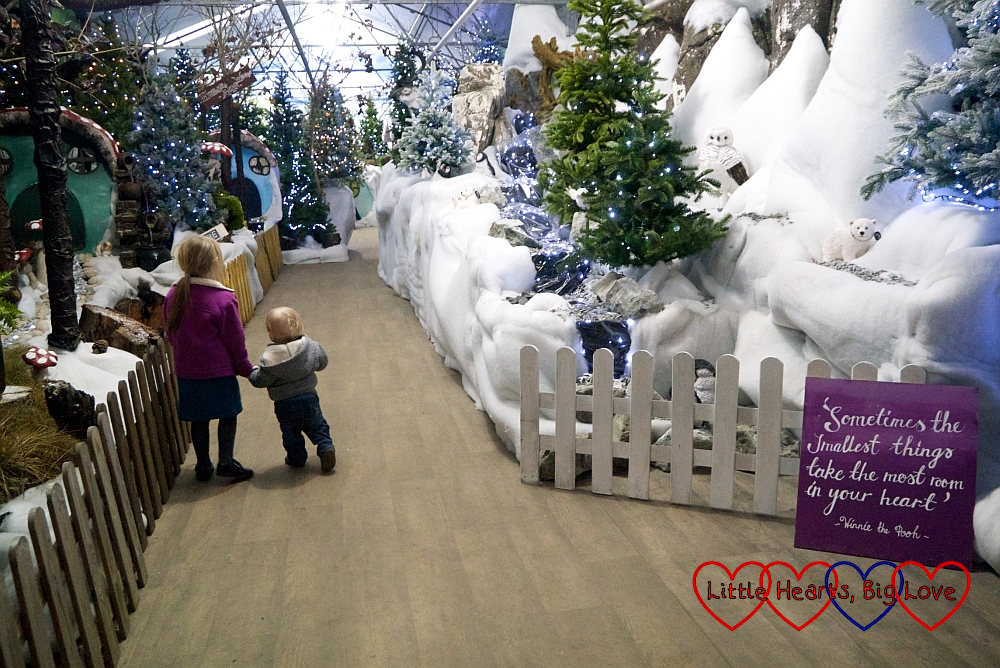 Sophie and Thomas walking hand-in-hand through the winter wonderland on the way to Santa's Grotto