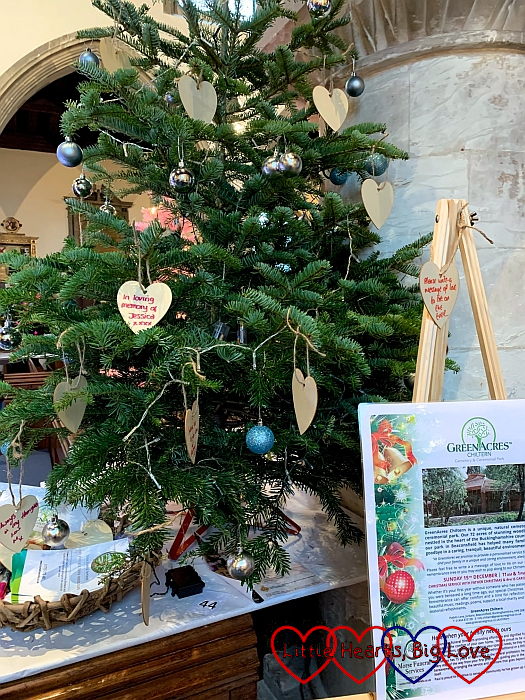 """The GreenAcres Christmas tree at the Christmas tree festival with my heart bauble with """"In loving memory of Jessica"""" written on it"""