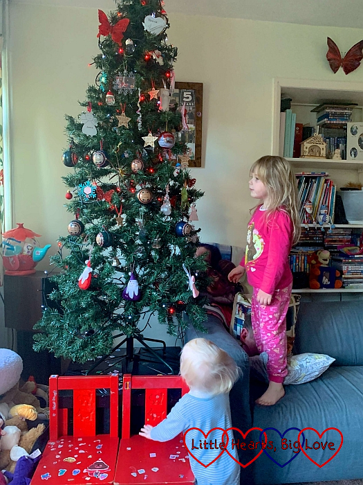 Sophie and Thomas looking at the Christmas tree