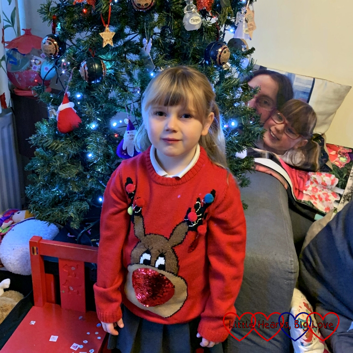 Sophie wearing her new Rudolph the red-nosed reindeer Christmas jumper