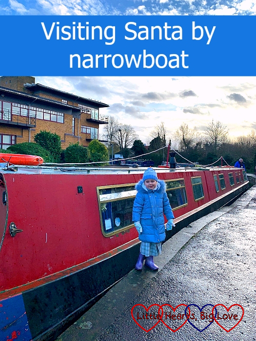 "Sophie standing in front of a red narrowboat - ""Visiting Santa by narrowboat"""