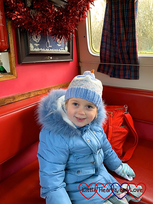 Sophie sitting inside the narrowboat