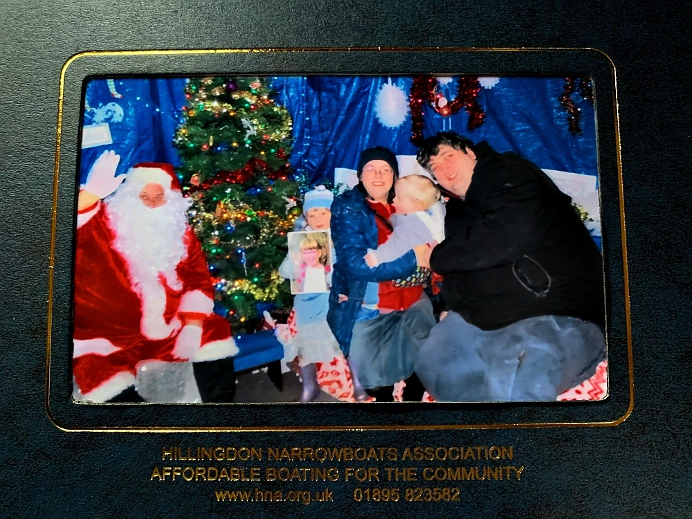The photo of me, hubby, Sophie (holding Jessica's photo) and Thomas with Santa