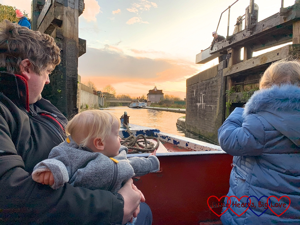 Hubby, Sophie and Thomas at the front of the narrowboat as it exits the lock