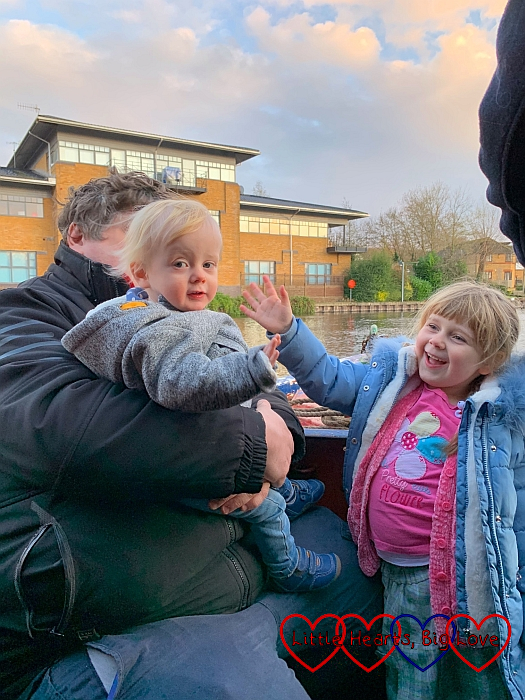 Hubby, Sophie and Thomas at the front of the narrowboat with Sophie giving Thomas a high-five