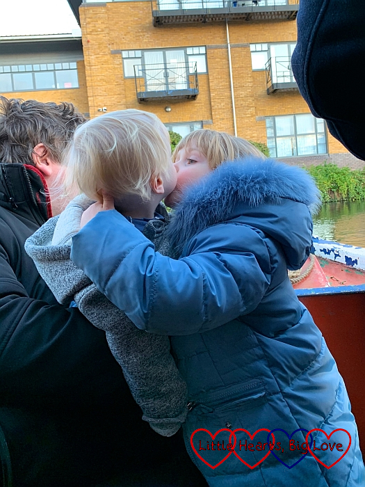 Hubby, Sophie and Thomas at the front of the narrowboat with Sophie giving Thomas a kiss