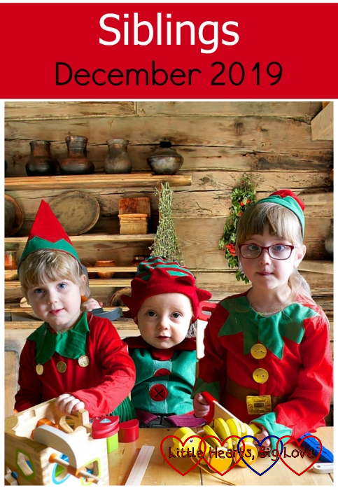 "Sophie, Thomas and Jessica dressed as Christmas elves at the table together with a log cabin background - ""Siblings - December 2019"""