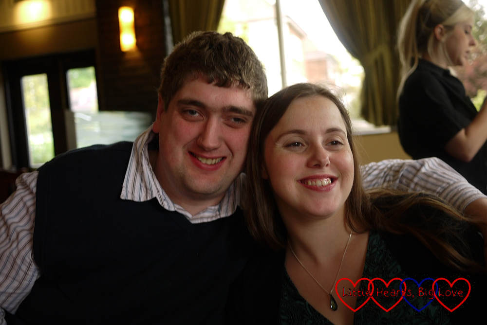 Hubby and me sitting in a restaurant in 2010