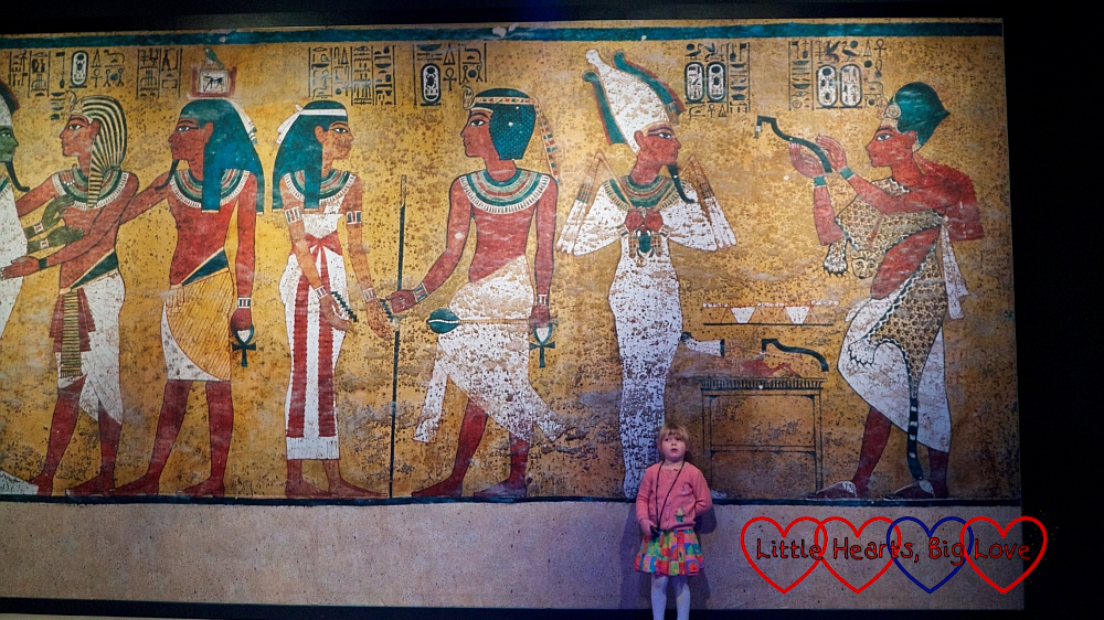 Sophie standing in front of an Egyptian mural