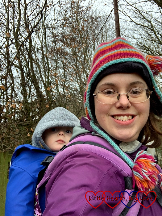 Thomas in his toddler carrier on my back