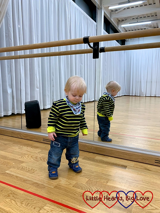 Thomas standing in front of the mirrors in the dance studio