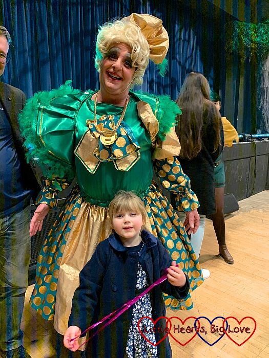 Sophie standing with the dame at the end of the pantomime