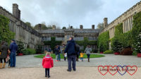 Hubby and Sophie standing in front of the house at Lanhydrock