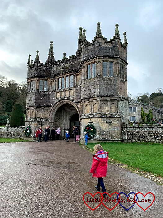 Sophie standing near the gatehouse at Lanhydrock