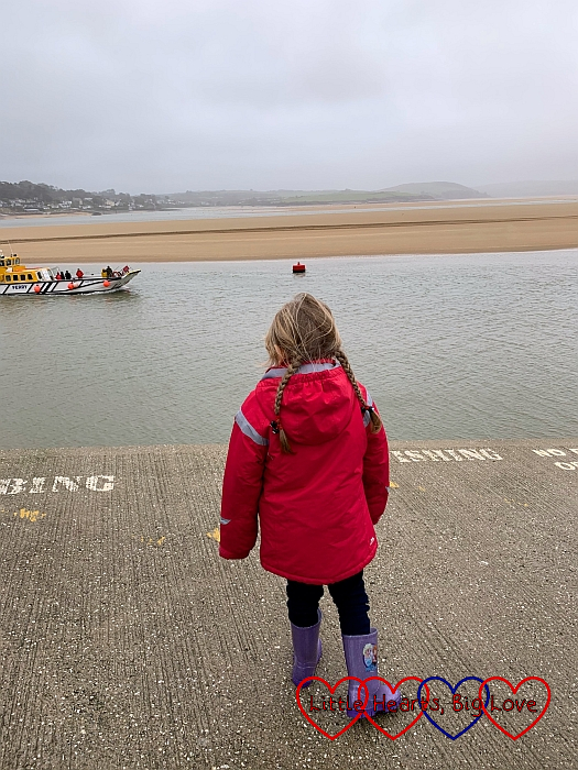 Sophie looking at the passenger ferry coming in towards the ferry slip at Padstow