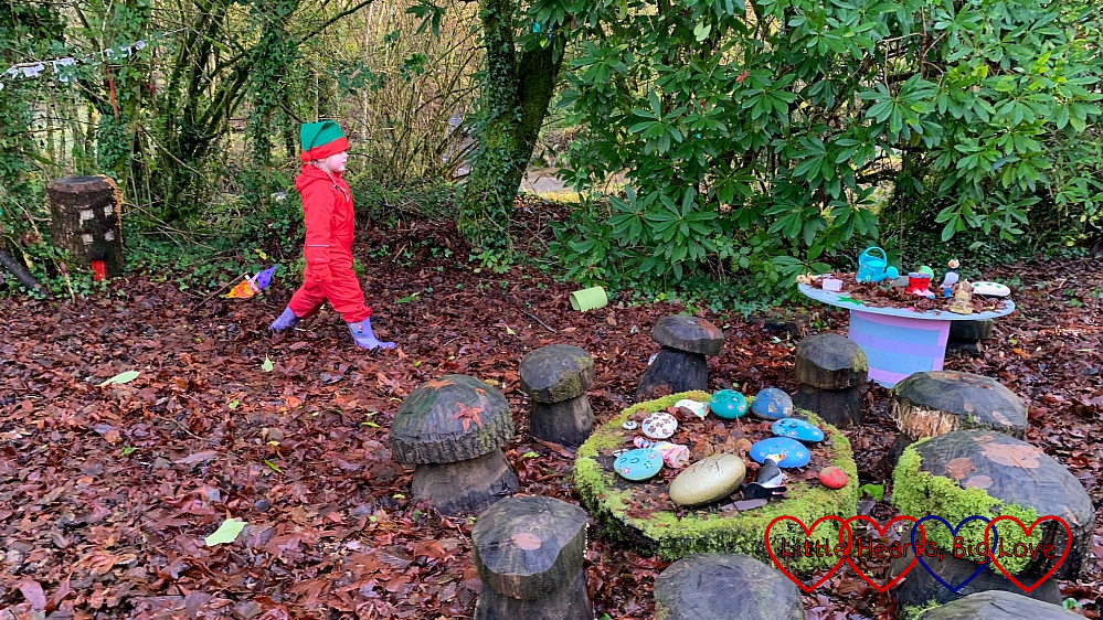 Sophie exploring the fairy garden at Coombe Mill