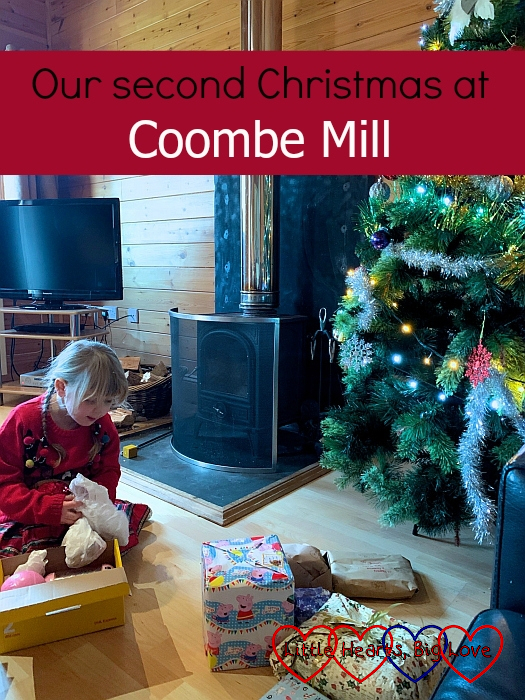 "Sophie opening presents in front of the Christmas tree in Heligan Lodge – ""Our second Christmas at Coombe Mill"""