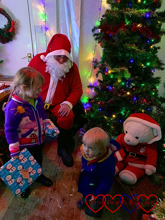 Sophie and Thomas with Father Christmas and Christmas Bear in Father's Christmas's grotto at Coombe Mill