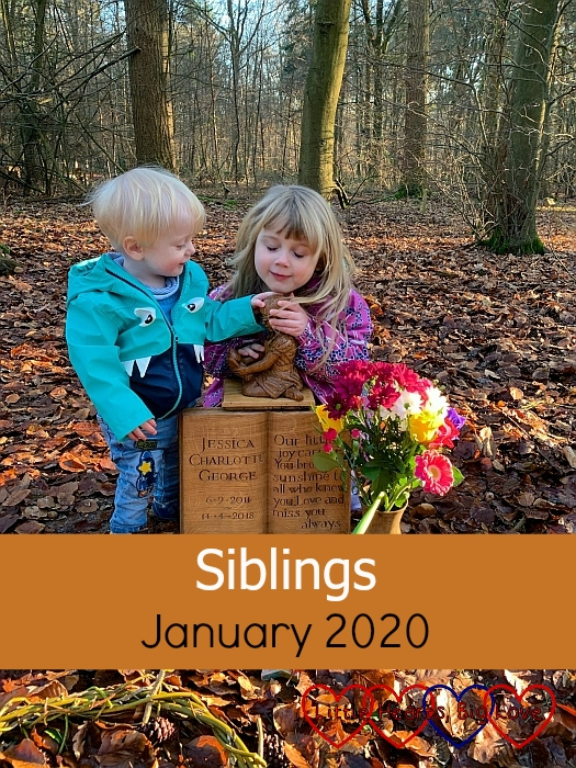 "Thomas and Sophie holding and looking at the carving of Jessica on her memorial at her forever bed - ""Siblings - January 2020"""