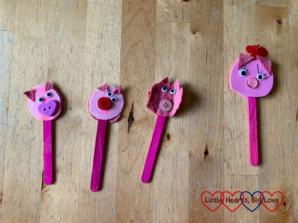 The three little pigs puppets made from pink felt and a craft stick; with Mummy Pig made from pink foam and a craft stick