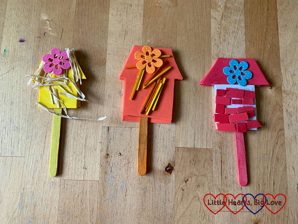 The three houses puppets (straw house, stick house and brick house) made from craft sticks, foam, raffia, matchsticks and foam 'bricks'