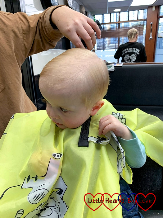 Thomas at the barber's having his hair cut