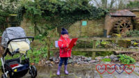 Sophie looking at her Beautiful Birds trail by the water wheel at Iver Environment Centre
