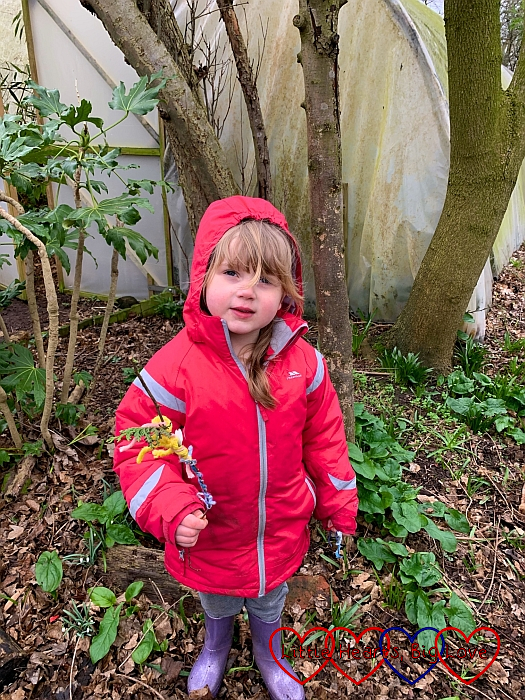 Sophie holding her fairy wand with its leaves and colourful pieces of wool