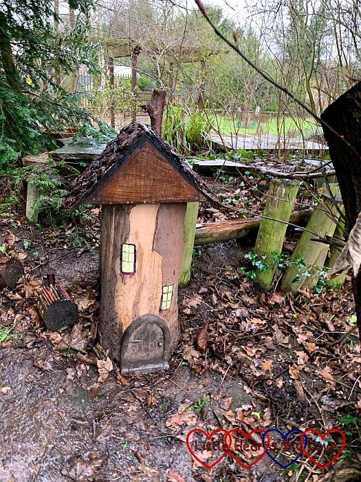 A fairy house carved into a log