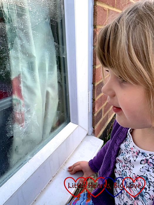 Sophie looking at the 'frost' patterns forming on the window