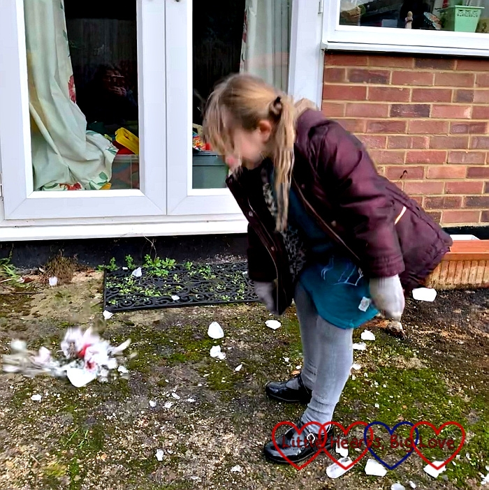 Sophie throwing a block of ice on the ground with ice flying off around it as it shatters