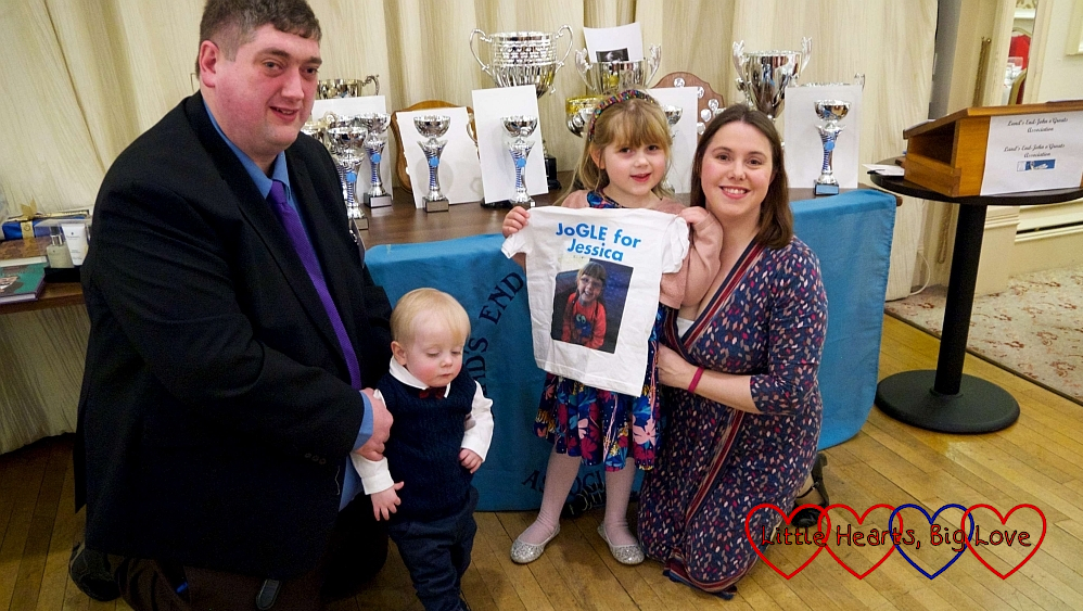 Hubby, Thomas, Sophie (holding her JoGLE for Jessica T-shirt) and me in front of the trophy table at the Land's End - John O'Groats Annual Dinner
